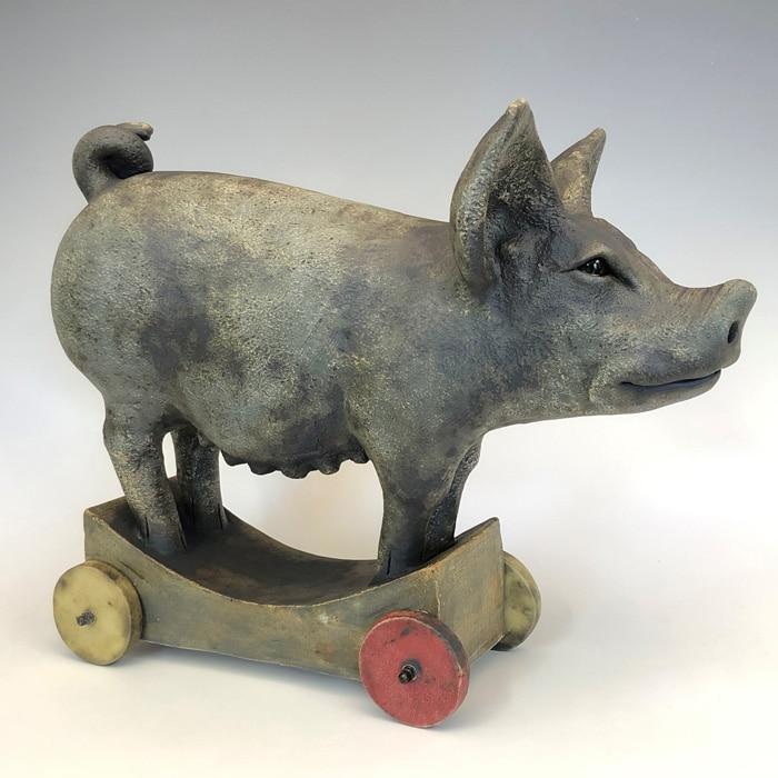 Ceramics-Jon-Barrett-Danes-Pig-on-wheels